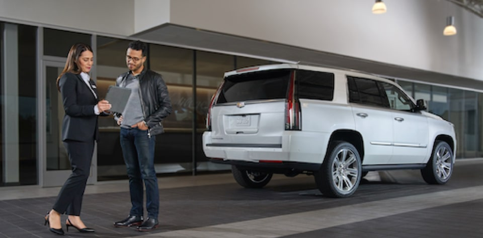 Cadillac Dealer Speaking with Client with Cadillac Escalade