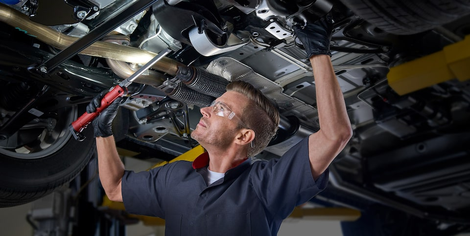 Cadillac Certified Service Technician Working Under the Hood