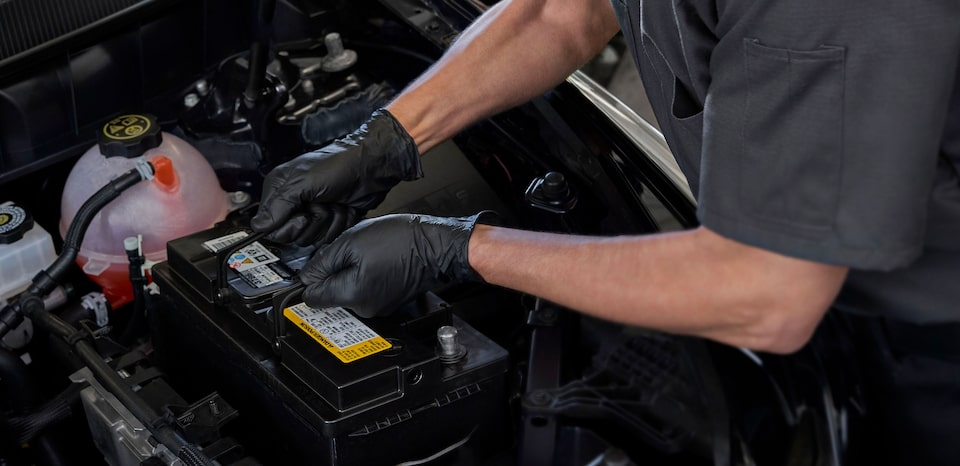 Cadillac Certified Service Technician Replacing A Vehicle's Battery