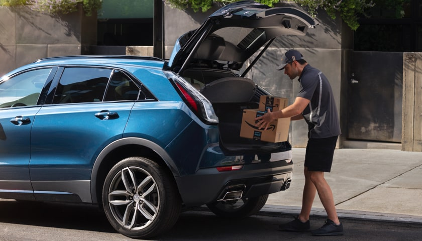 Cadillac Ownership Technology: Loading Amazon Package in Trunk