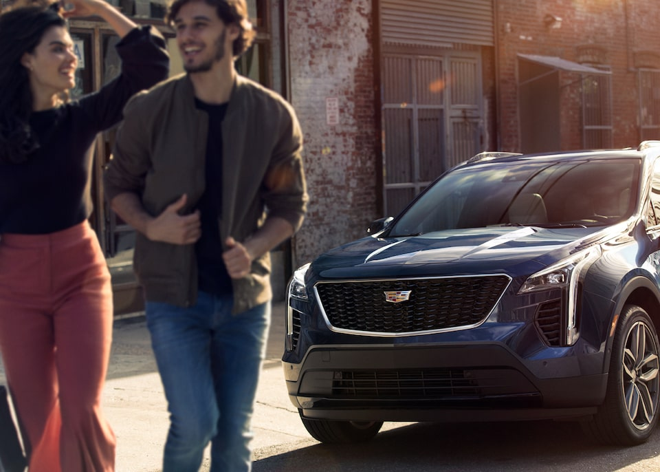 Cadillac Dealership Employee Discount Program: people walking from front view Cadillac SUV