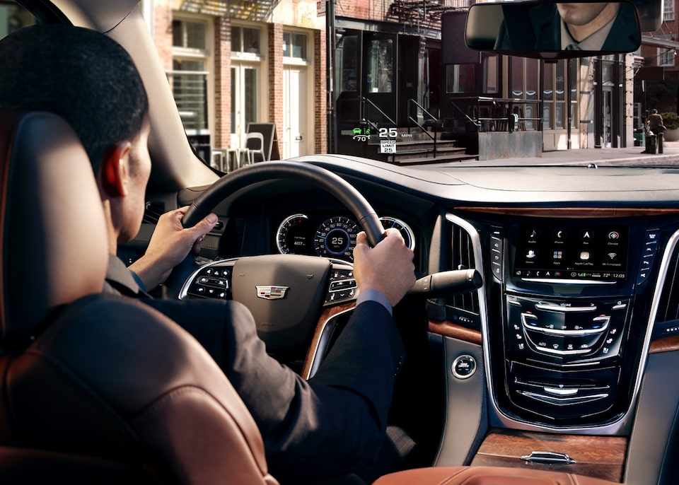 Cadillac Military Discount Program: Interior dashboard with a man driving