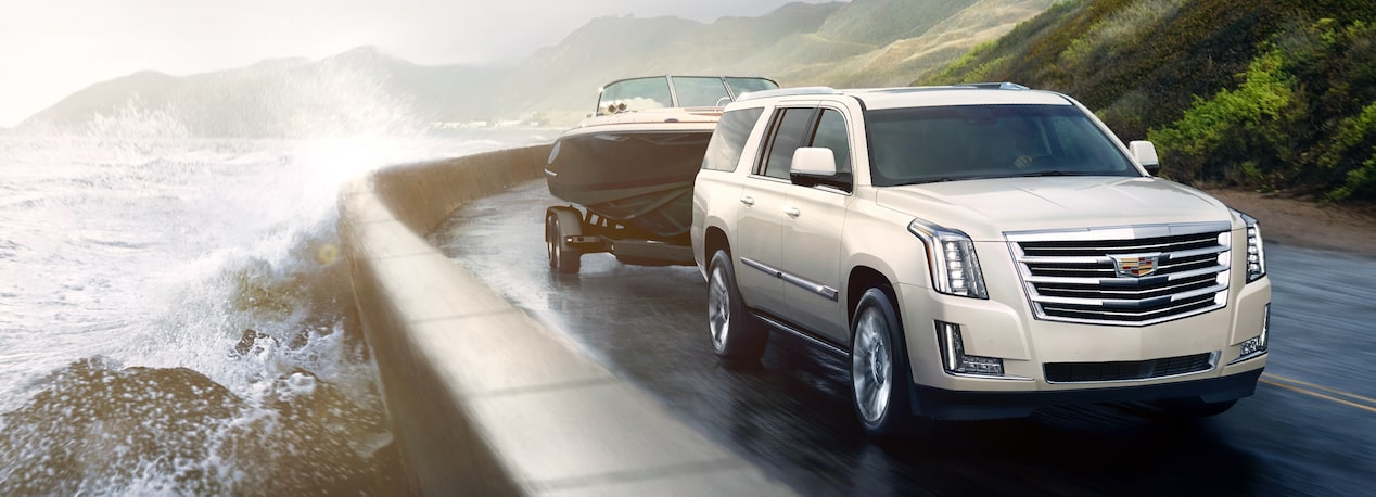 Escalade SUV Towing a Boat