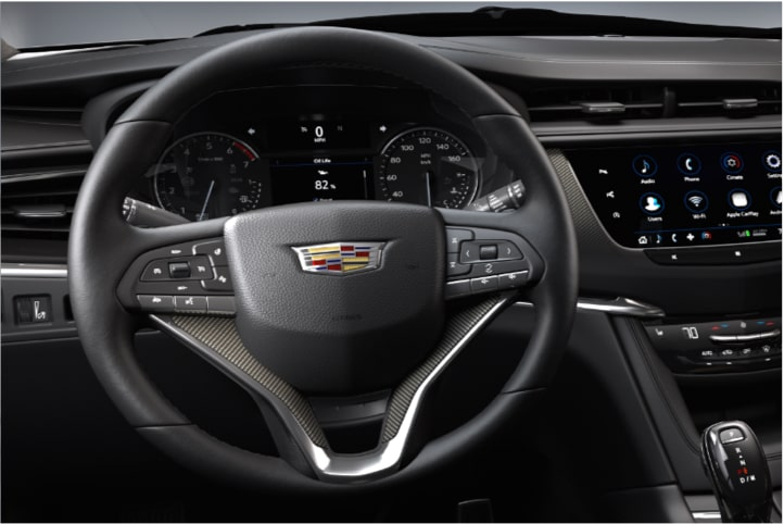 2020 Cadillac XT6 7 passenger mid-size SUV drive modes displayed by vehicle in motion