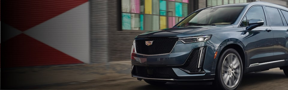 Cadillac XT6 7 Passenger Mid Size SUV front angle side view