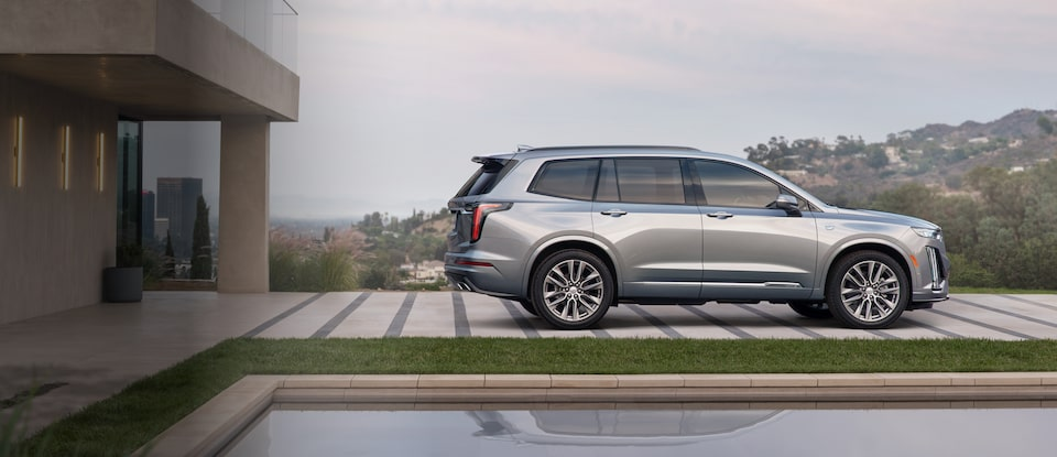 2020 Cadillac XT6 7 passenger mid-size SUV rear quarter panel in driveway
