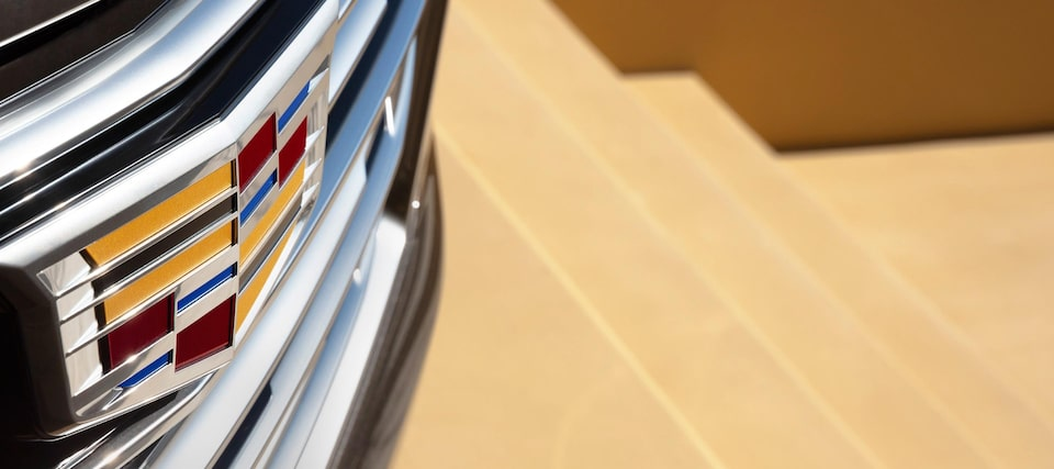 Cadillac logo on grille of vehicle