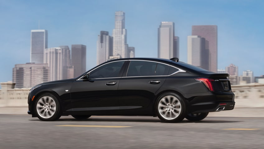 Black CT5 Side Profile View in front of Cityscape